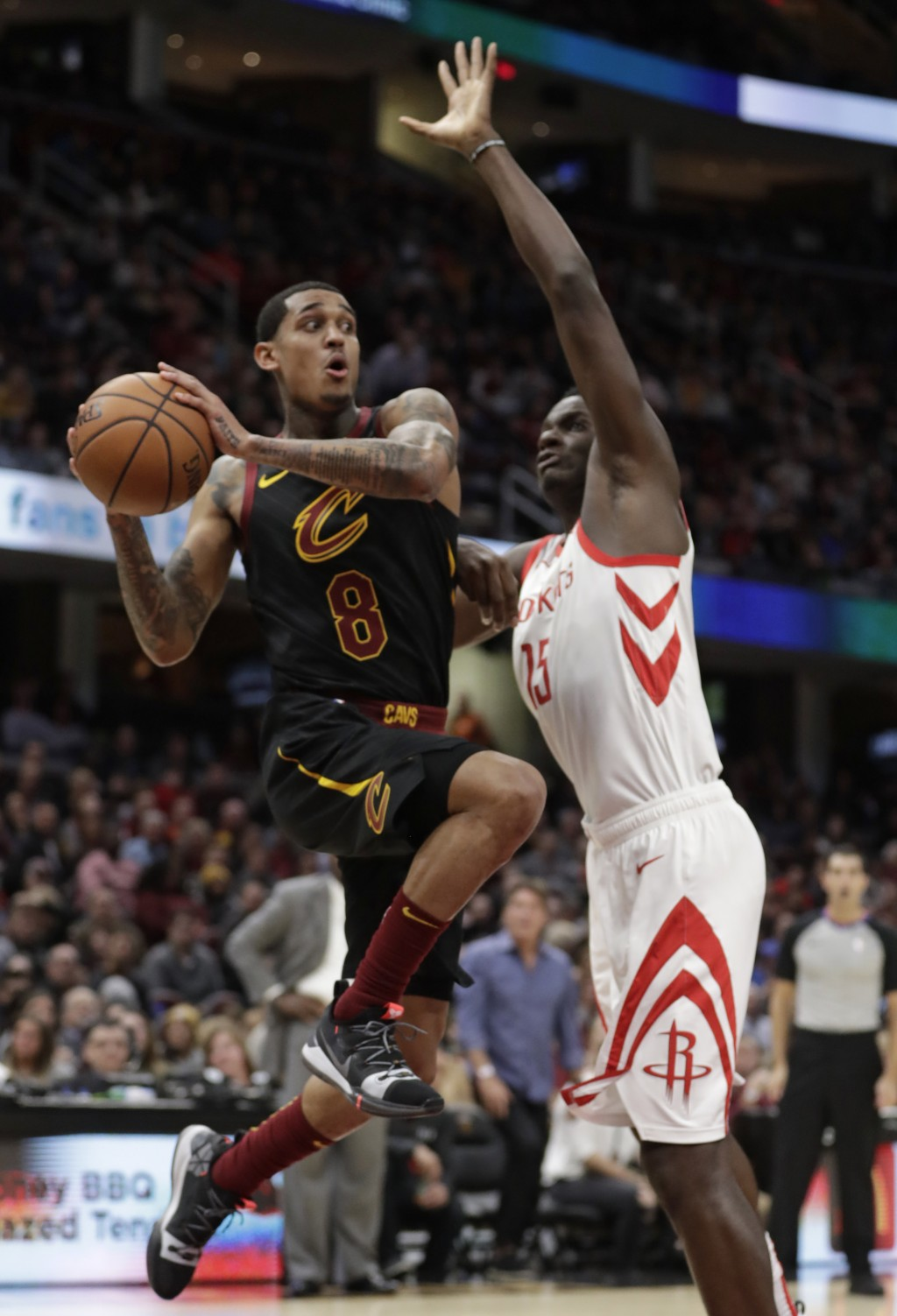 Cleveland Cavaliers' Jordan Clarkson (8) looks to pass against Houston Rockets' Clint Capela (15), from Switzerland, in the first half of an NBA baske...