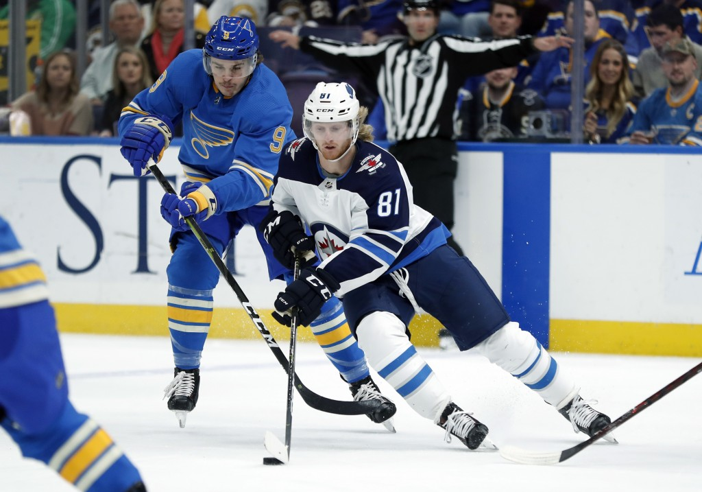 Winnipeg Jets' Kyle Connor (81) controls the puck as St. Louis Blues' Sammy Blais (9) defends during the first period of an NHL hockey game Saturday,