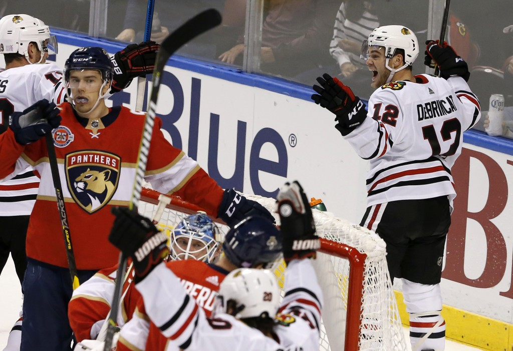 Chicago Blackhawks left wing Alex DeBrincat (12) celebrates his game-tying goal with seconds remaining in regulation against the Florida Panthers in a