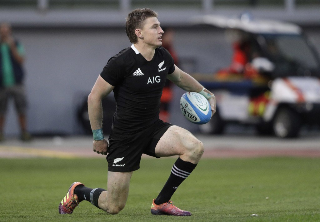 New Zealand's Damian McKenzie celebrates after scoring a try during the rugby union international match between Italy and New Zealand at the Olympic S