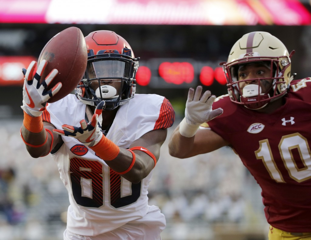 Syracuse wide receiver Taj Harris (80) catches a pass for a touchdown ahead of Boston College defensive back Brandon Sebastian (10) during the second