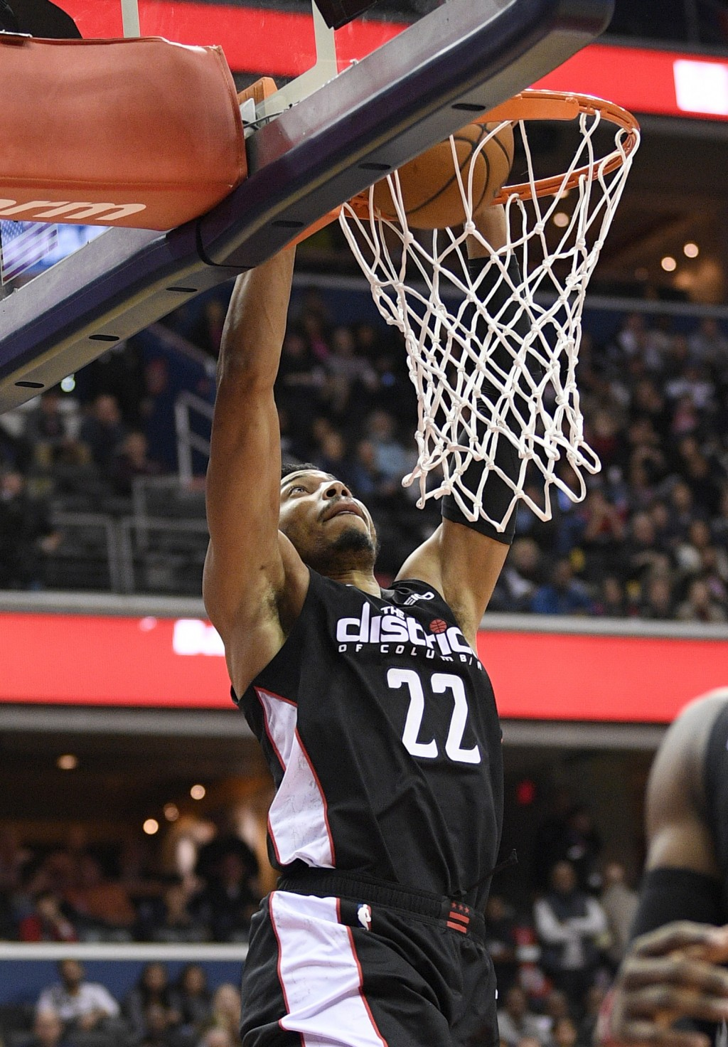 Washington Wizards forward Otto Porter Jr. (22) dunks during the second half of the team's NBA basketball game against the New Orleans Pelicans, Satur