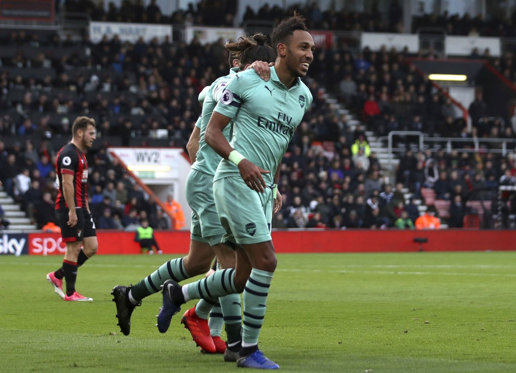Arsenal's Pierre-Emerick Aubameyang celebrates scoring his side's second goal of the game against Bournemouth during their English Premier League socc...
