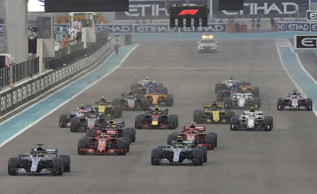 Mercedes driver Lewis Hamilton of Britain leads at the first corner after the start during the Emirates Formula One Grand Prix at the Yas Marina racet...