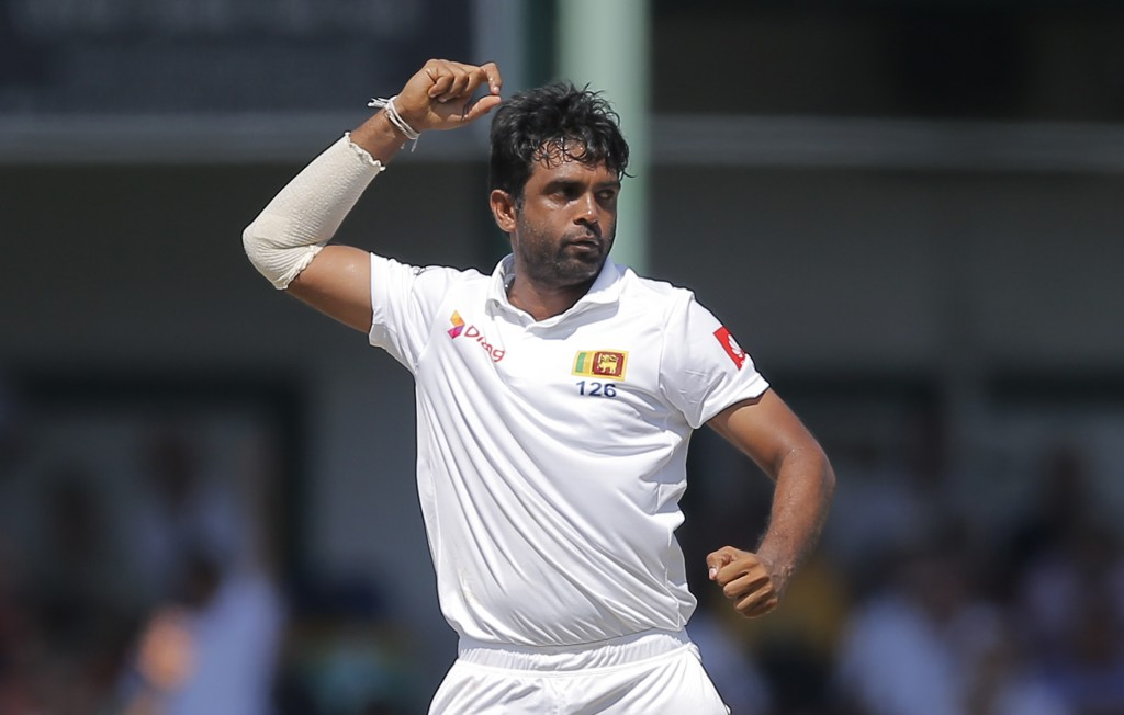Sri Lanka's Dilruwan Perera celebrates the dismissal of England's Rory Burns during the third day of the third test cricket match between Sri Lanka an...