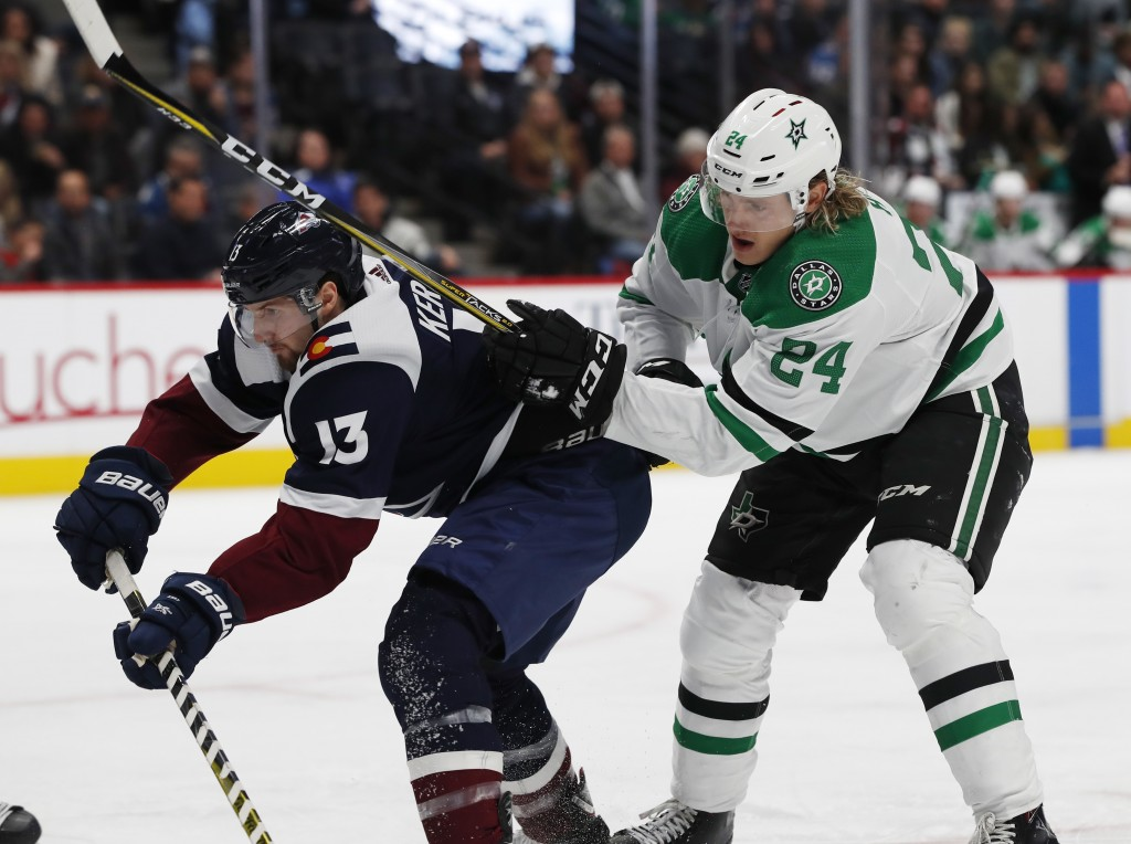 Colorado Avalanche center Alexander Kerfoot, left, passes the puck as Dallas Stars left wing Roope Hintz defends in the second period of an NHL hockey