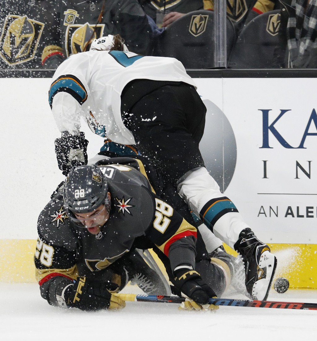 Vegas Golden Knights left wing William Carrier (28) falls against San Jose Sharks defenseman Erik Karlsson during the second period of an NHL hockey g...