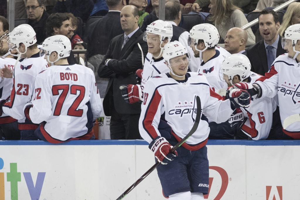 Washington Capitals left wing Jakub Vrana (13) celebrates at the bench after scoring a goal against the New York Rangers during the second period of a...