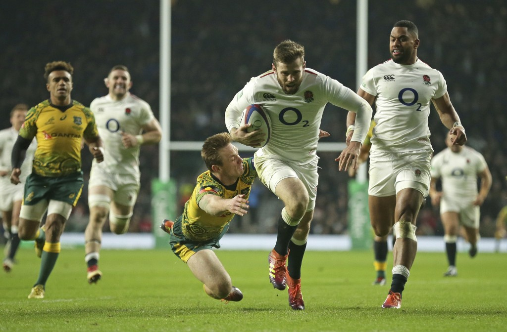 England's Elliot Daly, center, breaks clear to score a try during the rugby union international between England and Australia at Twickenham in London,...