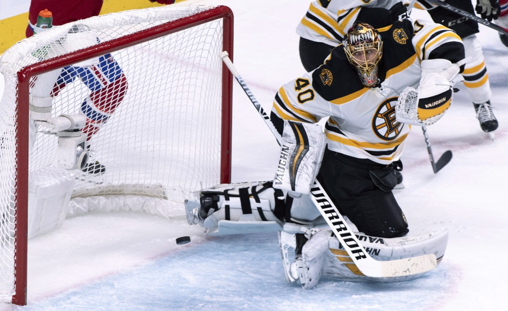 Boston Bruins goaltender Tuukka Rask looks back at the puck passing into the net on a goal by Montreal Canadiens' Tomas Tatar, not seen, during the th...