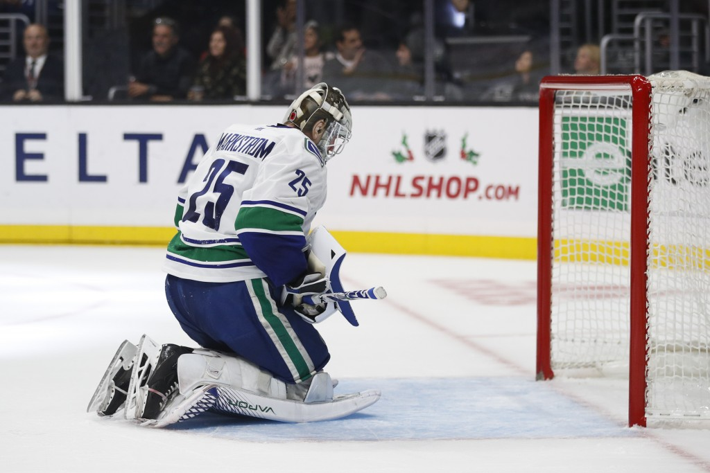 Vancouver Canucks goaltender Jacob Markstrom, of Sweden, reacts after allowing a goal to Los Angeles Kings' Matt Luff during the second period of an N