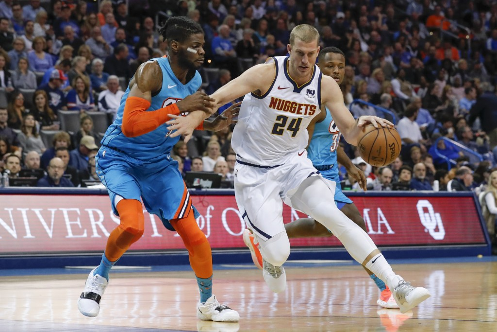 Denver Nuggets forward Mason Plumlee (24) drives to the basket around Oklahoma City Thunder forward Nerlens Noel (3) during the first half of an NBA b...