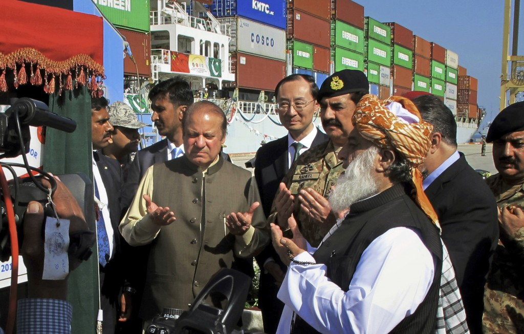 FILE - In this Nov. 13, 2016 file photo, then Pakistani Prime Minister Nawaz Sharif, center left, prays during the inauguration a new international tr