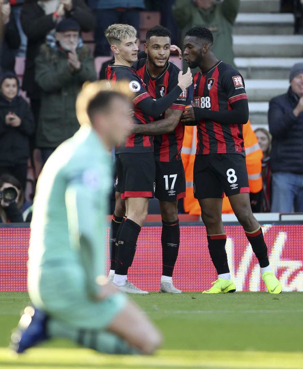 Bournemouth's Joshua King, center, celebrates with teammates after scoring his side's first goal during a Premier League soccer match between Bournemo...