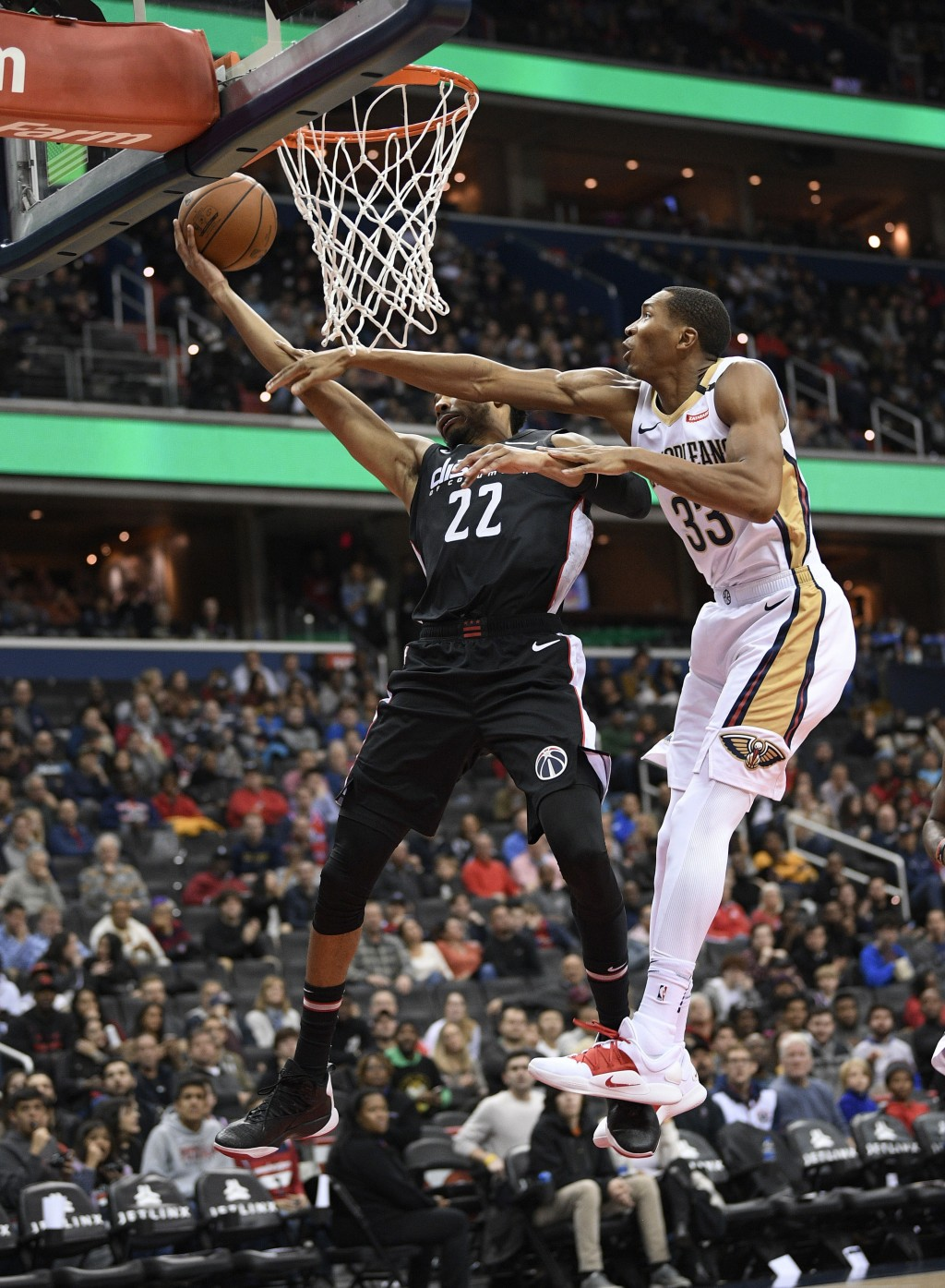Washington Wizards forward Otto Porter Jr. (22) is fouled by New Orleans Pelicans forward Wesley Johnson (33) during the second half of an NBA basketb...