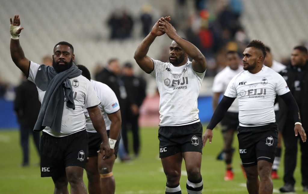 Fijian players wave to the crowd after defeating France 21-14 in their rugby international at Stade de France in Paris, Saturday, Nov. 24, 2018. (AP P...