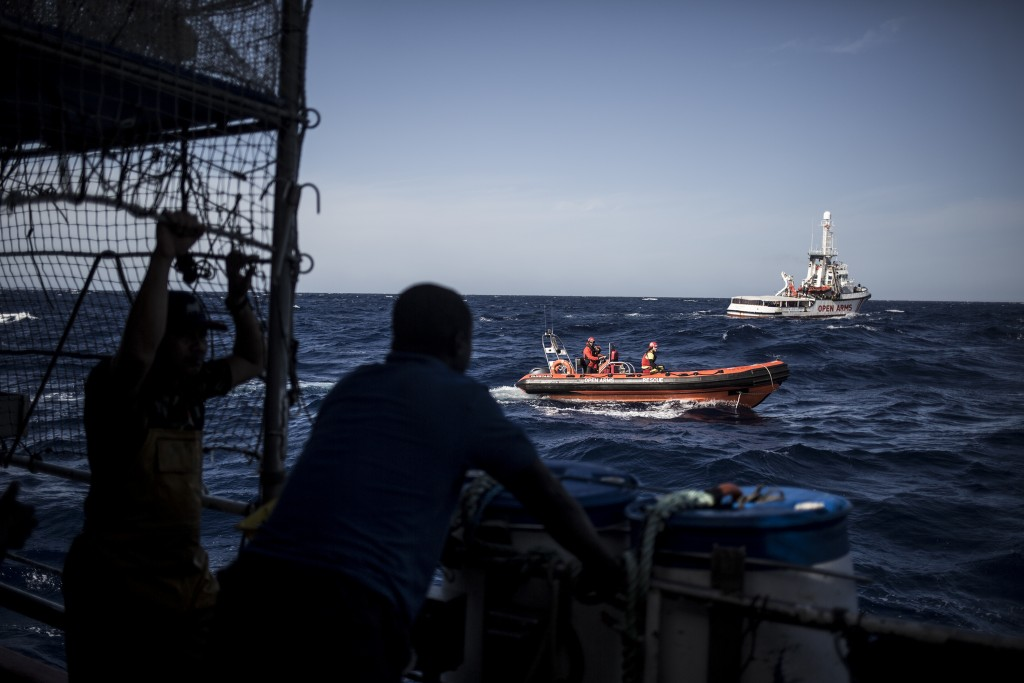 In this photo taken on Saturday, Nov. 24, 2018 photo, the Spanish NGO Proactiva Open Arms RIB vessel approaches Nuestra Madre de Loreto, a Spanish fis...