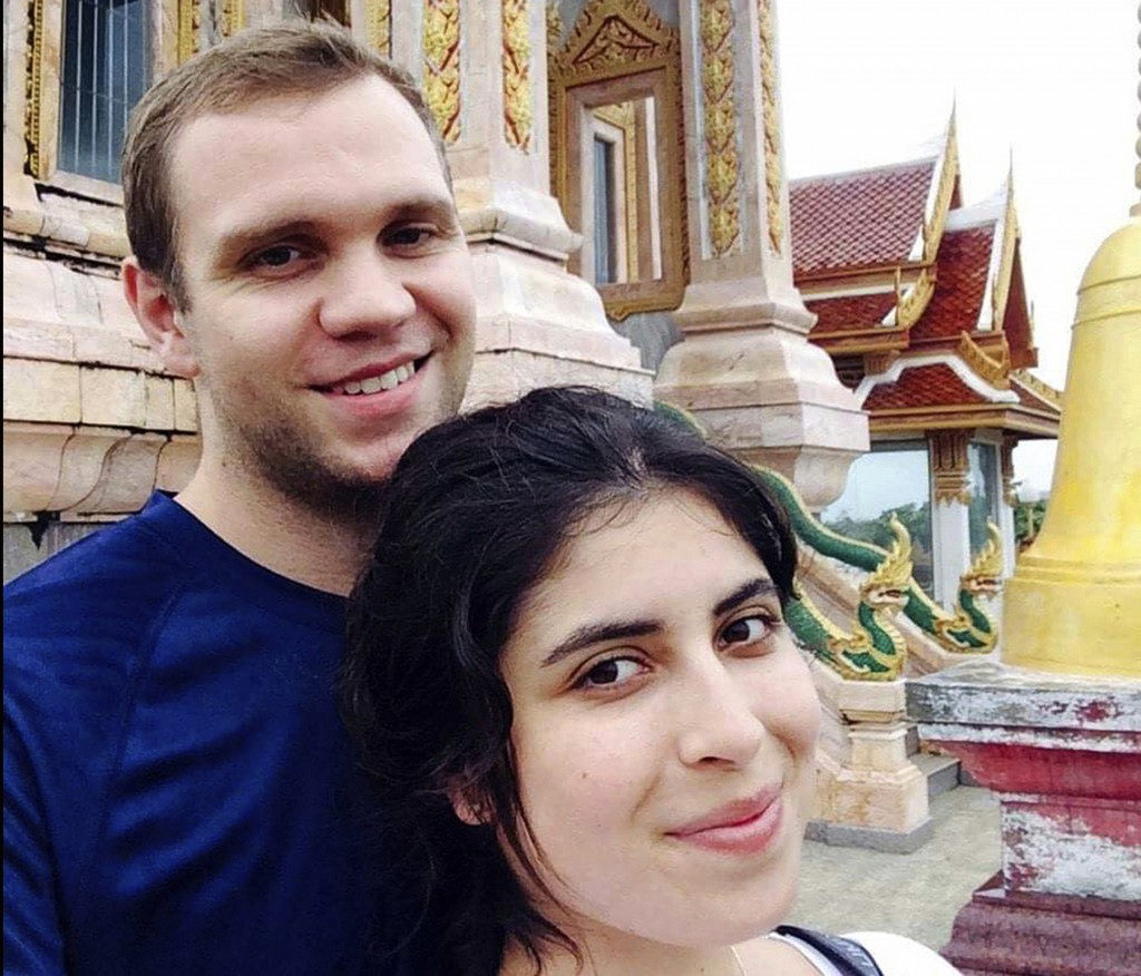 FILE - In this undated family photo, showing Matthew Hedges with his wife Daniela Tejada.  The United Arab Emirates has pardoned British academic rese...
