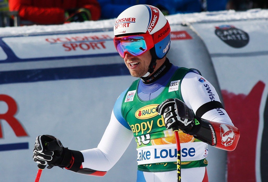 Mauro Caviezel, of Switzerland, reacts in the finish area at the men's World Cup super-G ski race at Lake Louise, Alberta, Sunday, Nov. 25, 2018. (Jef