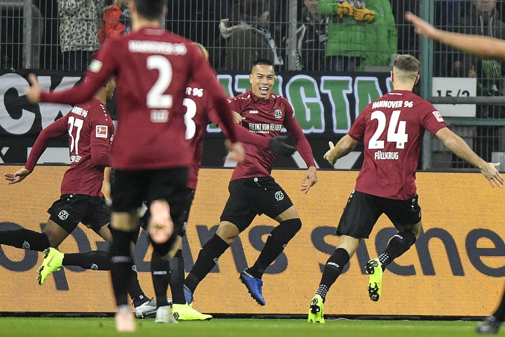 Hannover's Bobby Wood celebrates after scoring the opening goal in the first minute during the German Bundesliga soccer match between Borussia Moenche...