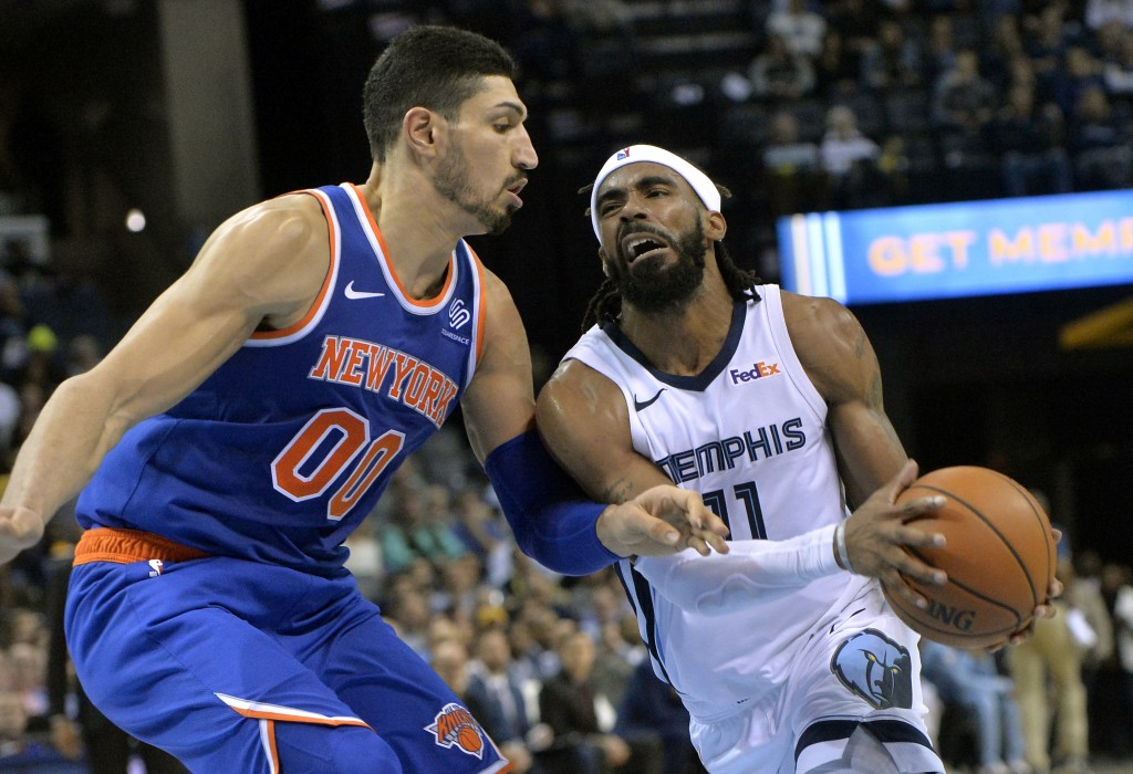 Memphis Grizzlies guard Mike Conley (11) drives against New York Knicks center Enes Kanter (00) in the second half of an NBA basketball game Sunday, N