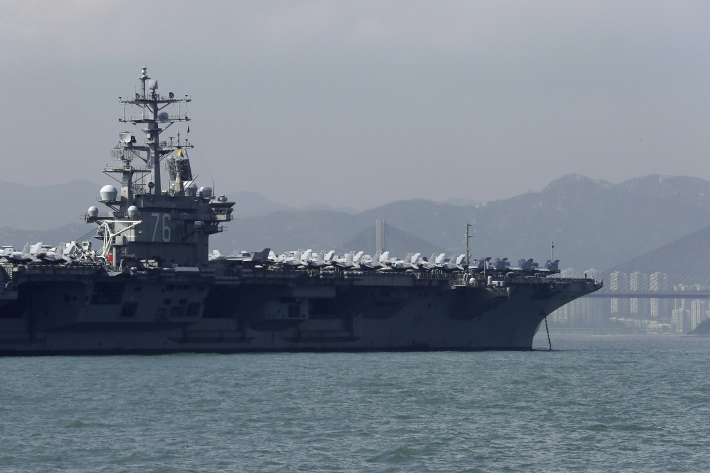 FILE - In this Wednesday, Nov. 21, 2018, the U.S. Navy's USS Ronald Reagan aircraft carrier is anchored in Hong Kong. The arrival of the USS Ronald Re...