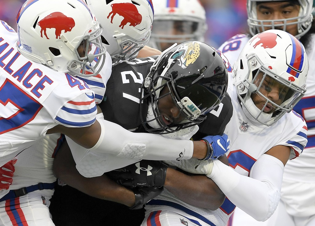 Jacksonville Jaguars running back Leonard Fournette (27) is tackled by Buffalo Bills defenders during the first half of an NFL football game, Sunday,