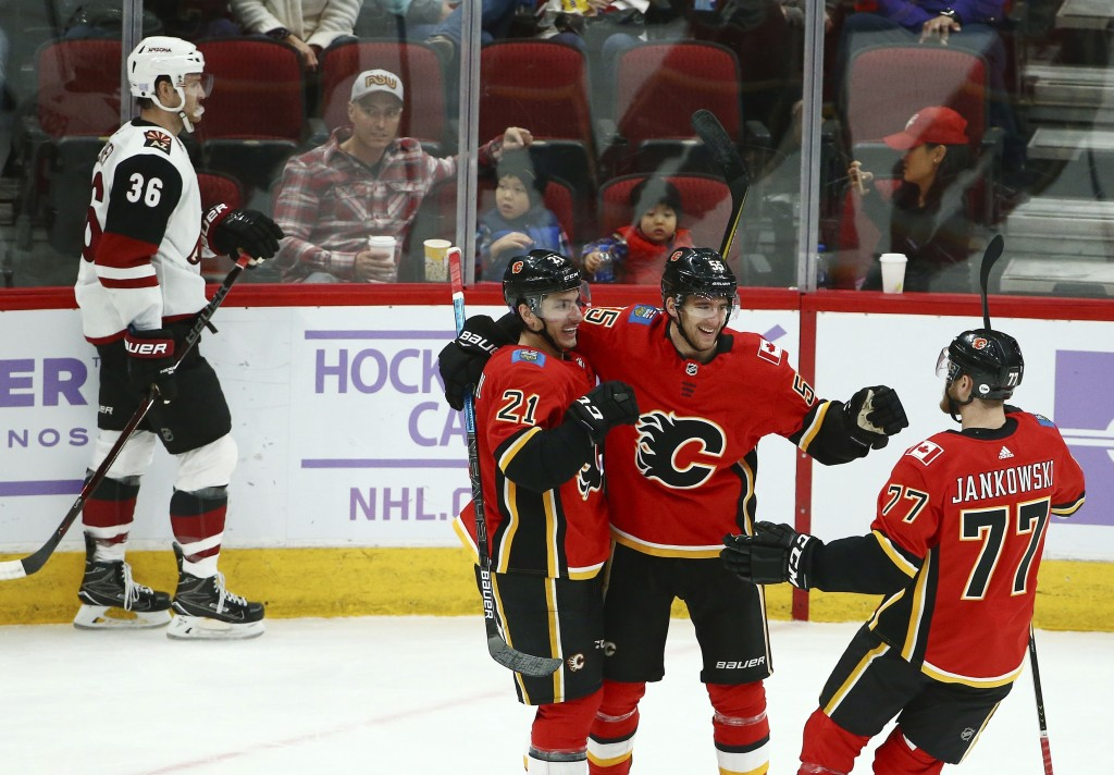 Calgary Flames defenseman Noah Hanifin (55) celebrates his short-handed goal against the Arizona Coyotes with Flames right wing Garnet Hathaway (21) a...