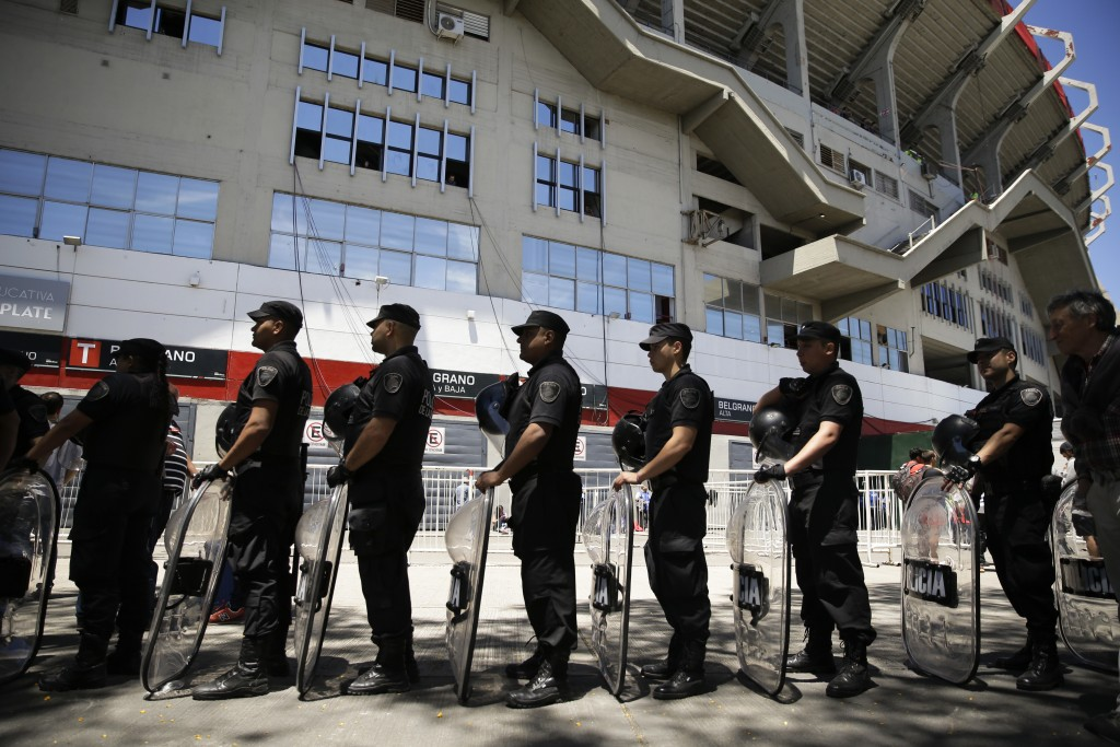 Riot police stand in line with their shields outside Antonio Vespucio Liberti stadium prior to the final Copa Libertadores match between Boca Juniors ...