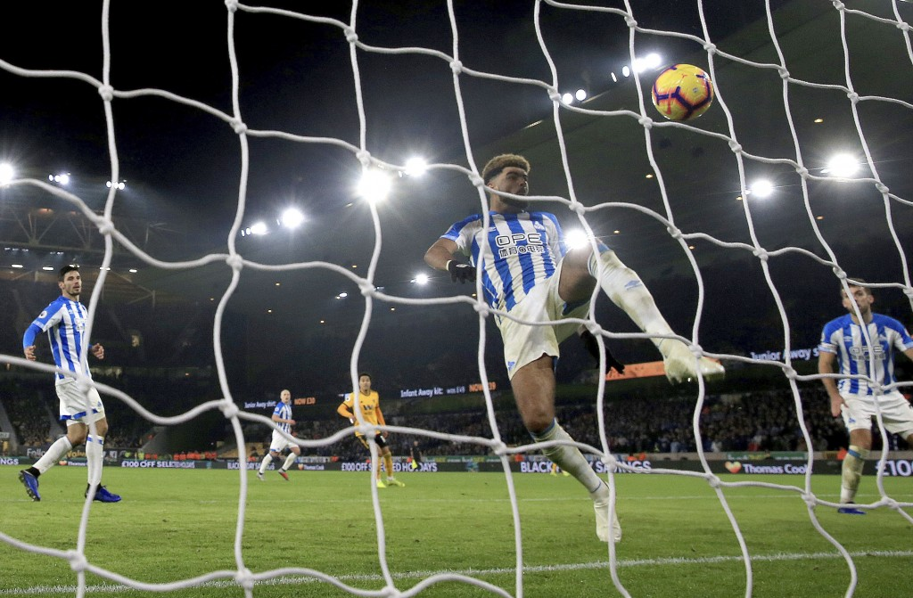 Huddersfield Town's Philip Billing clears the ball from the goal line following a headed attempt by Wolverhampton Wanderers' Raul Jimenez, during thei
