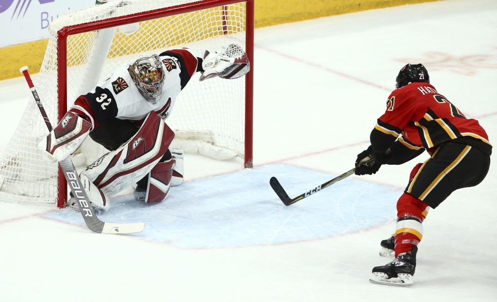 Arizona Coyotes goaltender Antti Raanta (32) gives up a short-handed goal to Calgary Flames Noah Hanifin during the first period of an NHL hockey game...