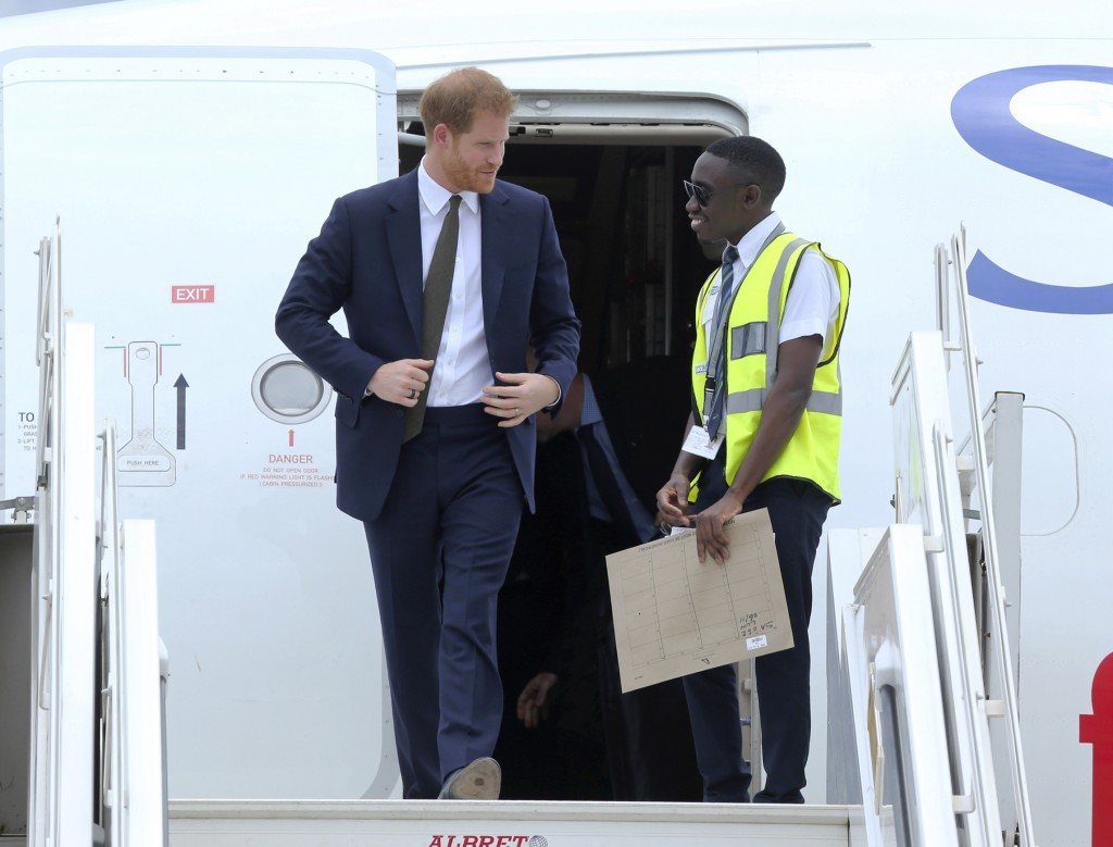 Britain's Prince Harry walks out of a plane upon his arrival at Kenneth Kaunda airport in Lusaka, Monday, Nov. 26, 2018. Prince Harry is on a State vi...