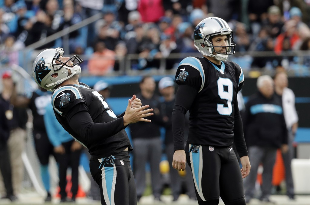 Carolina Panthers' Graham Gano (9) and Michael Palardy (5) watch as Gano's field attempt against the Seattle Seahawks goes wide during the second half...
