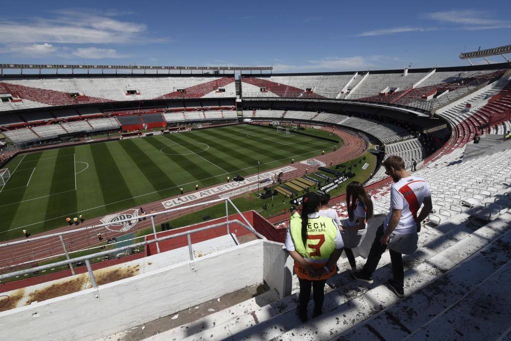 Fans of Argentina's River Plate soccer team leave Antonio Vespucio Liberti stadium after the final Copa Libertadores match against Boca Juniors was su...