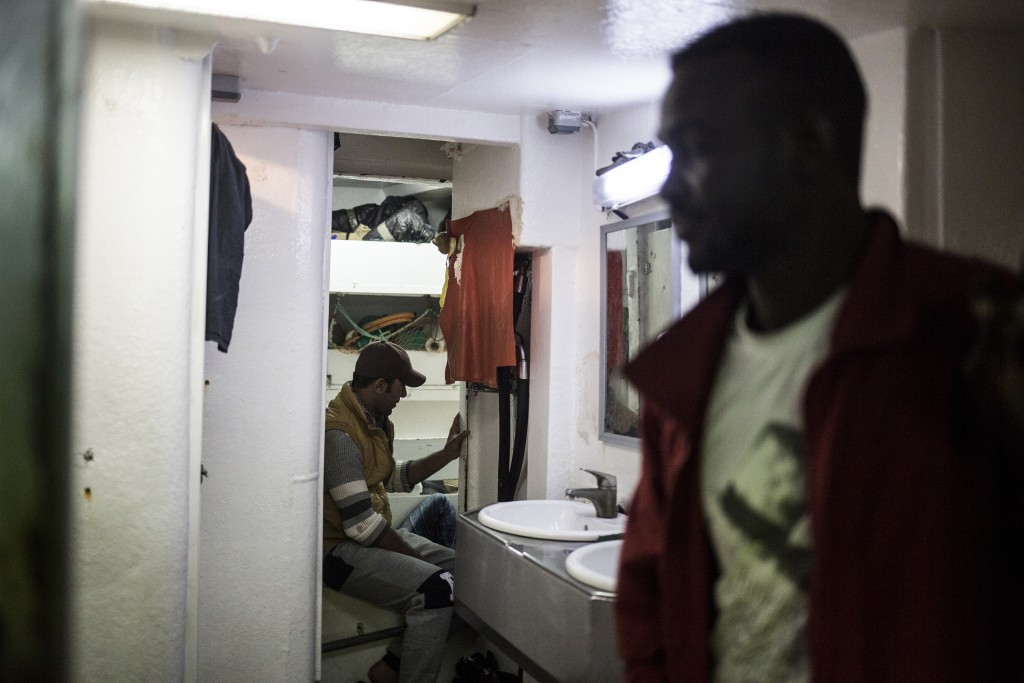 In this photo taken on Saturday, Nov. 24, 2018 photo, migrants rest on Nuestra Madre de Loreto, a Spanish fishing vessel that rescued twelve migrants ...