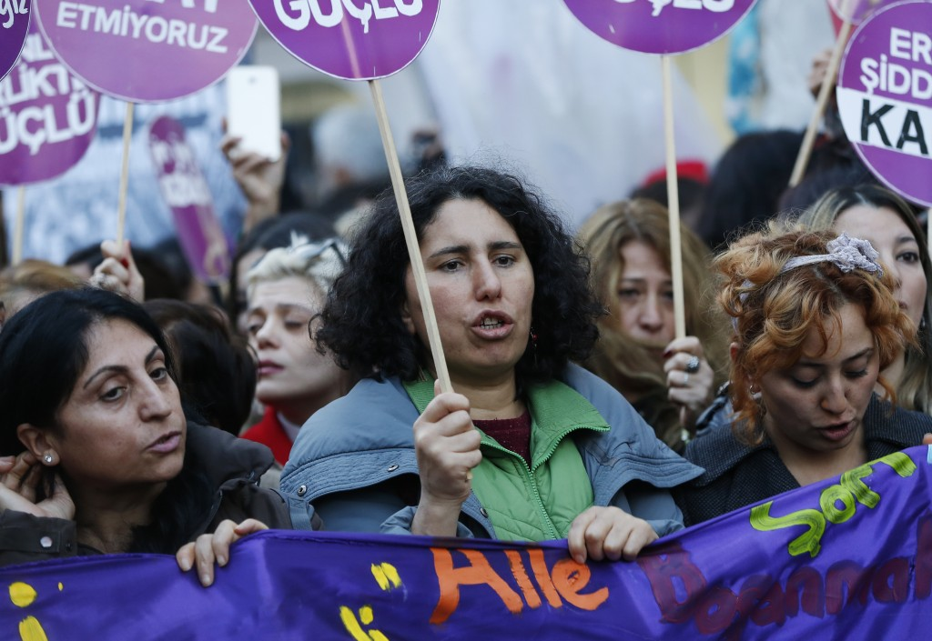 Protesters, displaying placards, chant slogans during a rally in central Istanbul, Sunday, Nov. 25, 2018, to mark the United Nations' International Da...