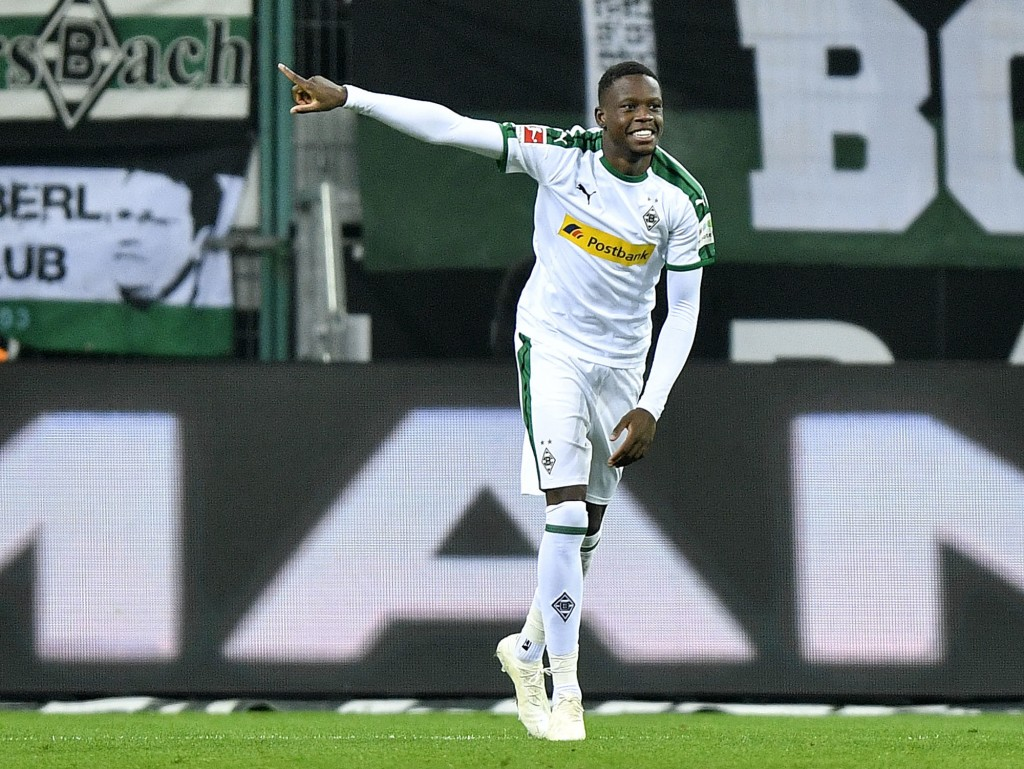 Moenchengladbach's scorer Denis Zakaria celebrates his side's 4th goal during the German Bundesliga soccer match between Borussia Moenchengladbach and...