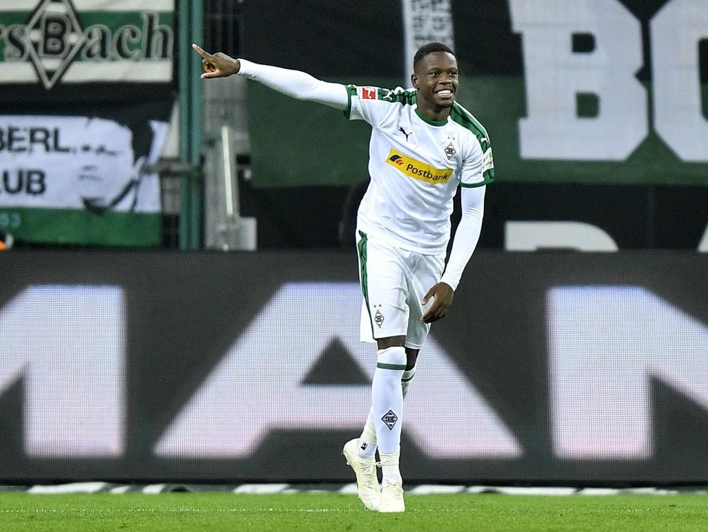 Moenchengladbach's scorer Denis Zakaria celebrates his side's 4th goal during the German Bundesliga soccer match between Borussia Moenchengladbach and