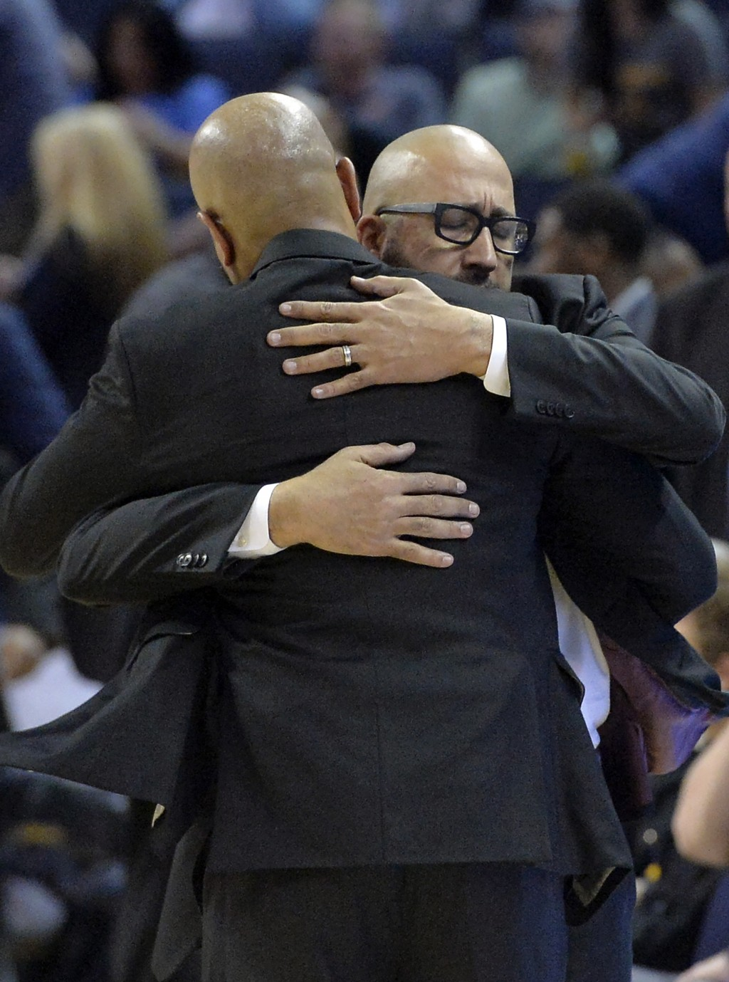 Memphis Grizzlies coach J.B. Bickerstaff, foreground, and New York Knicks coach David Fizdale greet each other after an NBA basketball game Sunday, No