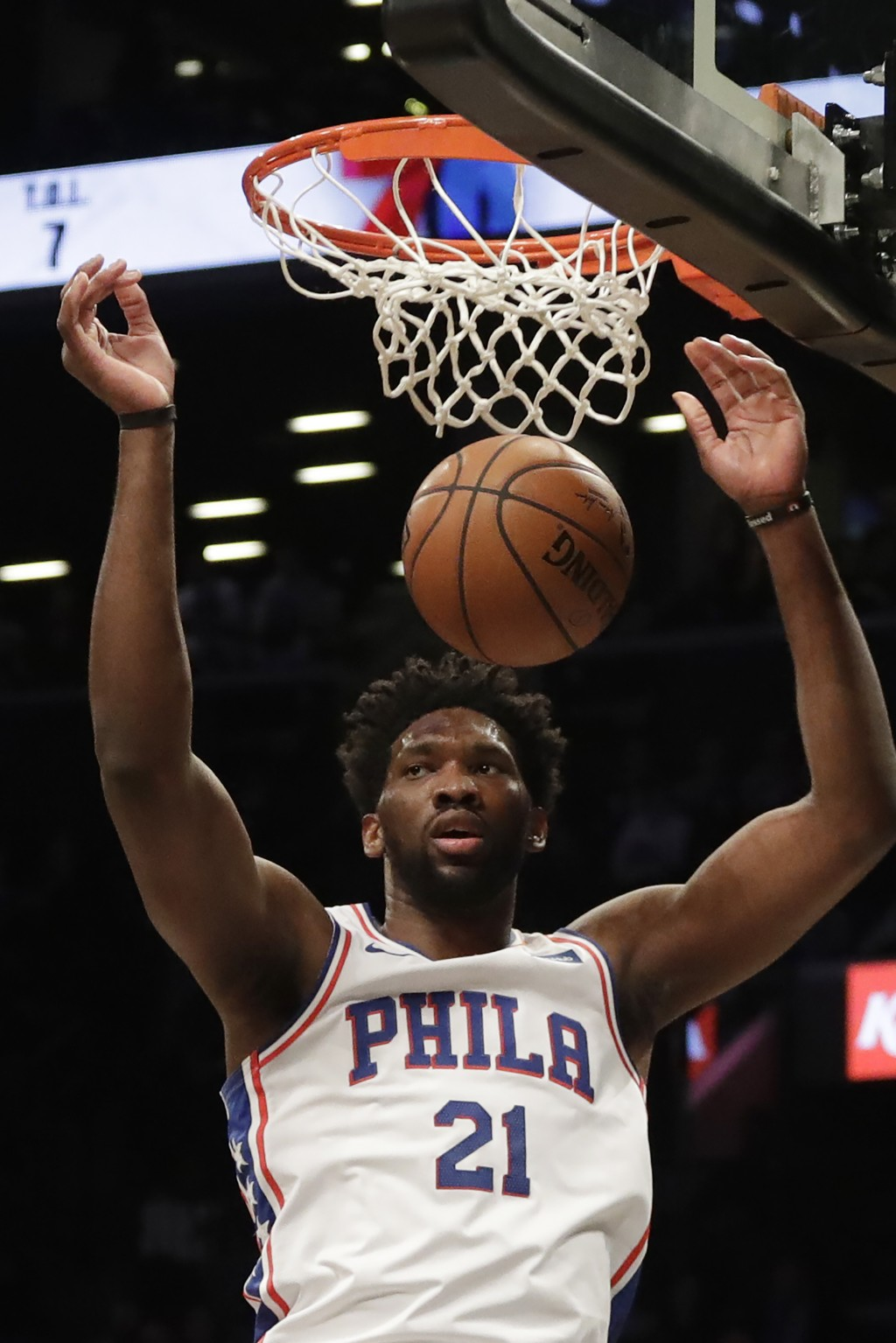 Philadelphia 76ers Joel Embiid (21) dunks in the first quarter of a basketball game against the Brooklyn Nets, Sunday, Nov. 25, 2018, in New York. (AP
