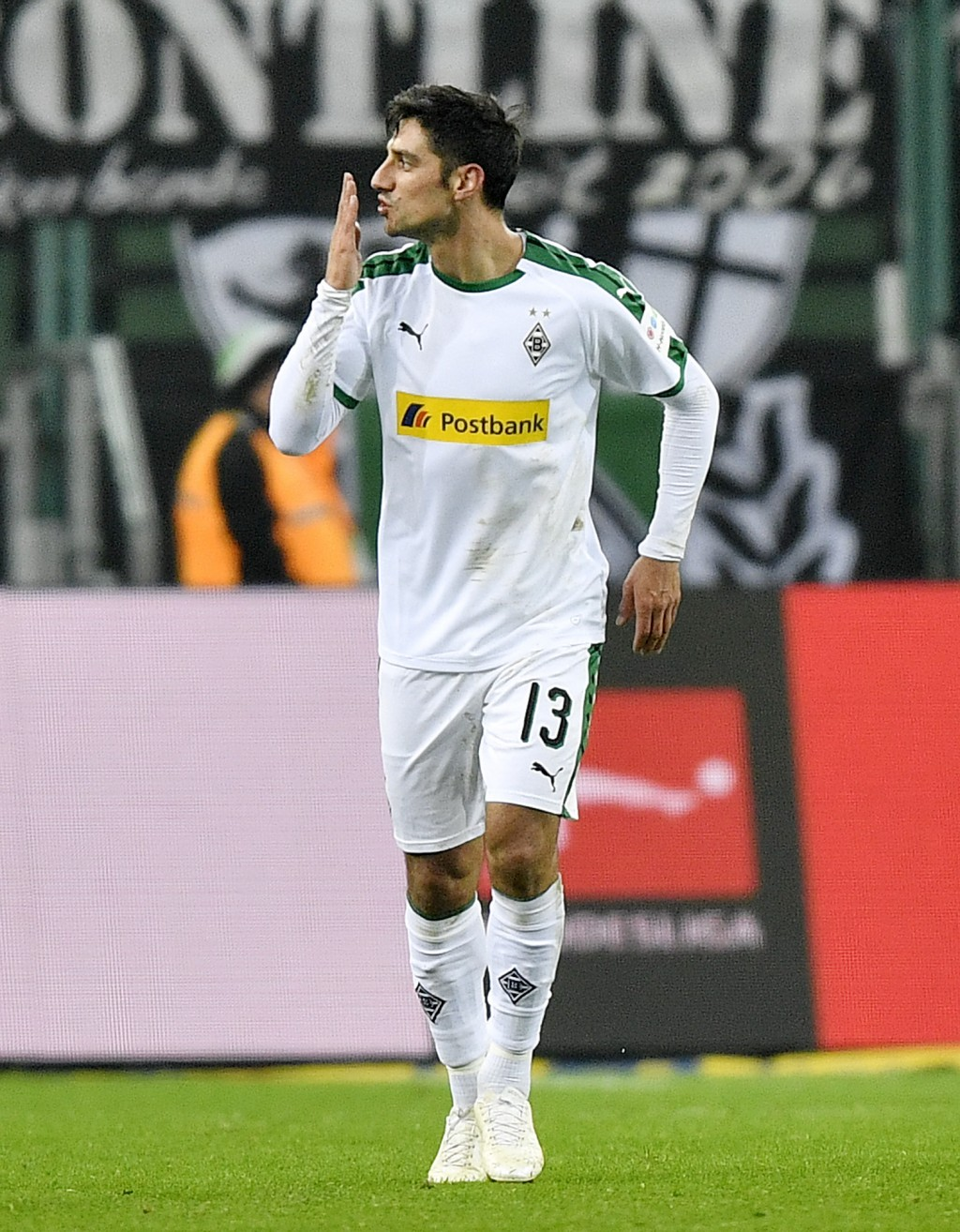 Moenchengladbach's Lars Stindl celebrates after scoring his side's third goal during the German Bundesliga soccer match between Borussia Moenchengladb...