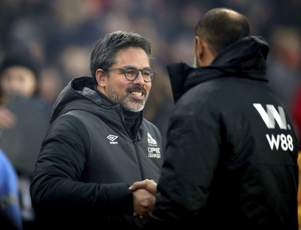 Huddersfield Town manager David Wagner, left, shakes hands with Wolverhampton Wanderers manager Nuno Espirito Santo ahead of a Premier League soccer m...