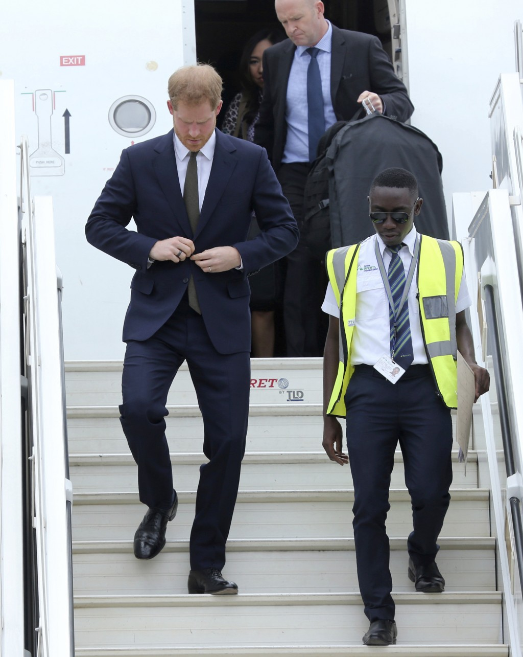 Britain's Prince Harry walks down the plane steps upon his arrival at Kenneth Kaunda airport in Lusaka, Monday, Nov. 26, 2018. Prince Harry is on a St...