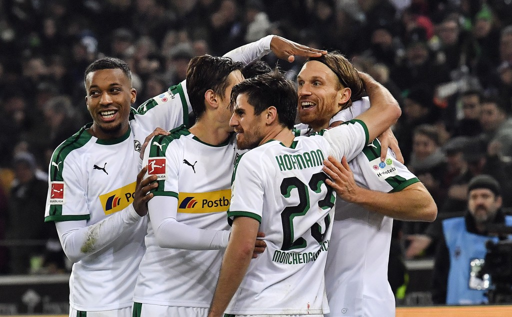 Moenchengladbach's Michael Lang, right, is celebrated after scoring his side's second goal during the German Bundesliga soccer match between Borussia