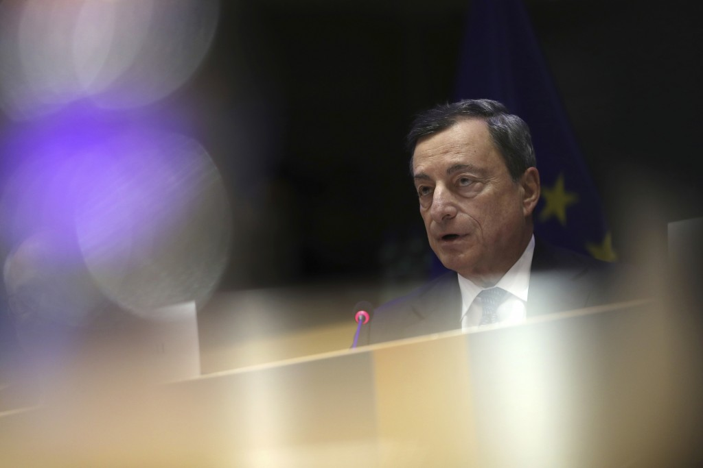 European Central Bank President Mario Draghi speeches during an Economic and Monetary Affairs meeting at the European Parliament in Brussels, Monday, ...