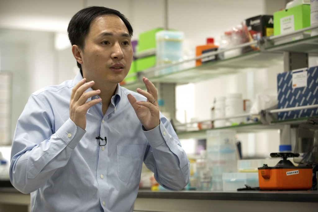 In this Oct. 10, 2018 photo, He Jiankui speaks during an interview at a laboratory in Shenzhen in southern China's Guangdong province. Chinese scienti...