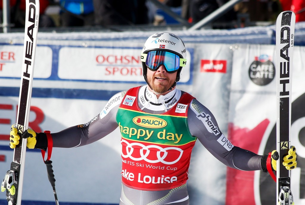 Kjetil Jansrud, of Norway, reacts in the finish area at the men's World Cup super-G ski race at Lake Louise, Alberta, Sunday, Nov. 25, 2018. (Jeff McI...