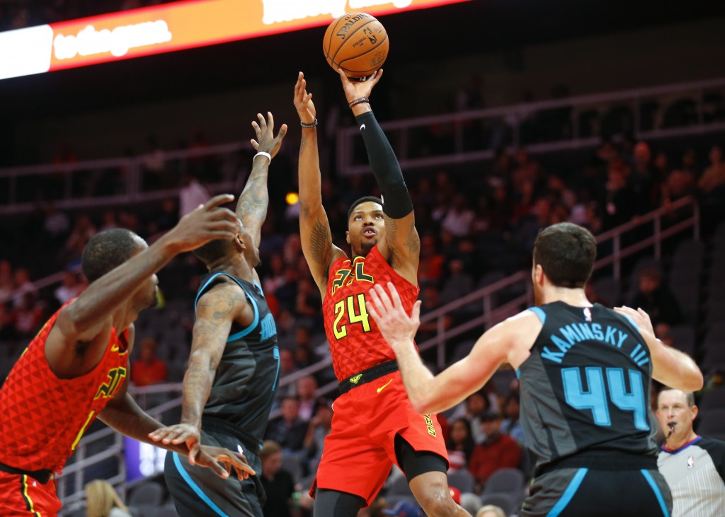 Atlanta Hawks guard Kent Bazemore (24) shoots in the first half of an NBA basketball game against the Charlotte Hornets on Sunday, Nov. 25, 2018, in A
