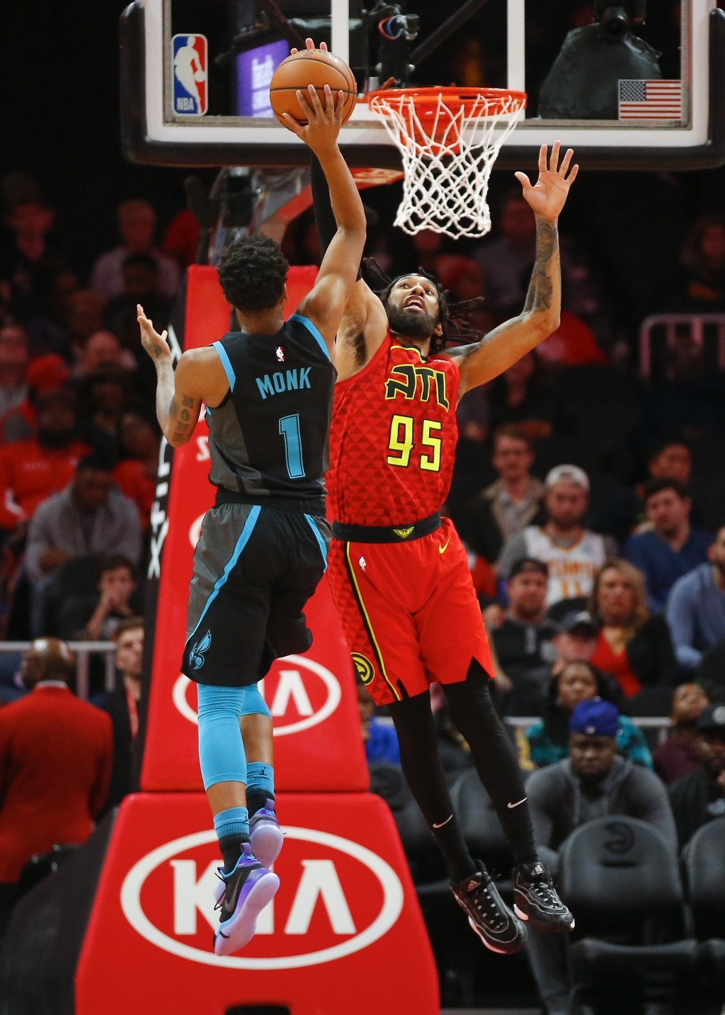 Charlotte Hornets guard Malik Monk (1) shoots as Atlanta Hawks forward DeAndre' Bembry (95) defends in the first half of an NBA basketball game on Sun