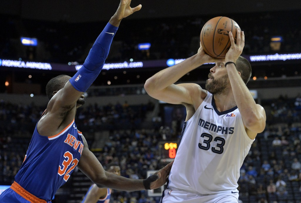 Memphis Grizzlies center Marc Gasol (33) shoots against New York Knicks forward Noah Vonleh (32) in the second half of an NBA basketball game Sunday,